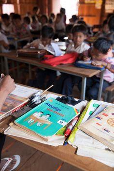 Teacher's books and children in class, UWS Jong Ra School, #Cambodia #education