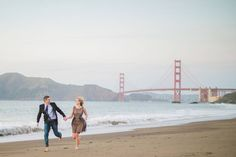 Love this! Couple running at Baker Beach in San Francisco with Golden Gate Bridge in the background!