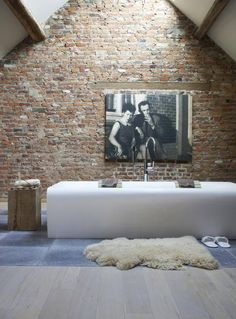 Bathroom. Bathtub. Tub. Brick Wall. A-Frame. Attic. Photography. Rustic. Retreat. Decor. Interior Design. Skylight.
