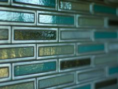 Sparkling glass tile inlaid in recycled aluminum. The tile, from artist Erin Adams' Luna Collection, was created in collaboration with Pedro Hernandez. Glass Tile Backsplash, Beadboard Backsplash, Backsplash Ideas, Kitchen Pictures, Room Pictures, Hgtv Kitchens, Foyer Furniture, Hgtv Dream Homes, Le Far West