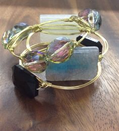 The Aurora Stackelette by FancyStacks on Etsy, $38.50. A set of 3 wire wrapped bangles. Available in Gold, Rose Gold or Silver. Standard and Custom Sizes available. The perfect, unique gift for bridesmaids, maid of honor, mothers day, birthdays and any special occasion.