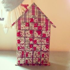 My Christmas craft advent calendar house for the twins. Going to put treats in each drawer. Made from decopatch papers and glue. The numbers are felt and the frame is from hobbycraft. Red and tarten theme. The kids will love it hopefully :)