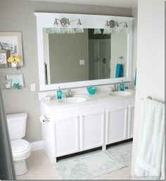 Framing a large bathroom mirror   See the huge difference some paint and a frame make in this bathroom. Unbelievable!