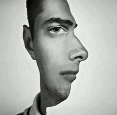 Do you see a man's profile or half of his face?