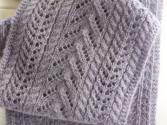 Easy as Pie Scarf - 3.99 for the pattern, introduction to cables and lace.  Fingering weight yarn.