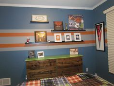 4 year old sons sport theme bedroom., Blue walls with orange and gray stripes. Sports theme with football, basketball, hockey, and baseball., Dresser and shelves are from IKEA. Love the dresser. I think it is fun for a kids room, Boys Rooms Design
