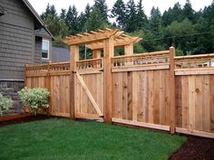 timber fence and arbour