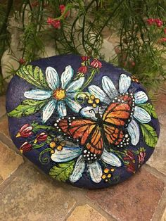 Monarch butterfly / daisies painted rock