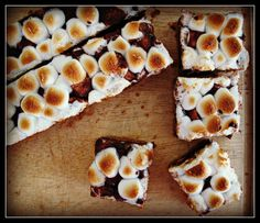 smores bars with a momofuku twist; graham cracker crust; a mini mallow and milk chocolate ganache and momofuku cornflake crunch mixture for the filling, and on top some torched mallows