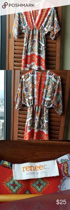 Renee C. Boho Tunic Fabulous tunic with 3/4 length sleeves.  Features a deep V neck with elastic around the waist. Size is a small but runs a little large.  Only worn a few times.  100% Polyester Renee C. Tops Tunics