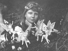 The first Cottingley photograph. France and the Fairy Ring. July, 1917.