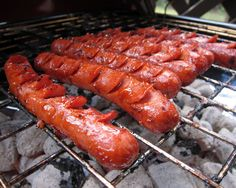 4 different types of hot dogs.  Grilled hot dogs, corn dogs, bacon crescent dogs and chili dogs