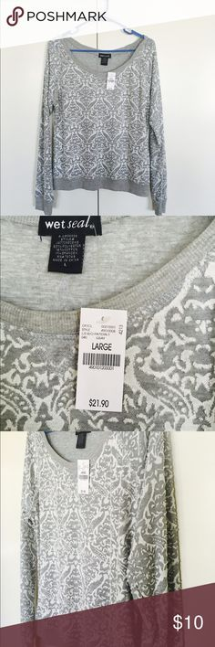 Longsleeve brand-new with tag never worn:) Very light weight good to wear in the summer, beautiful design, and never worn with tags Wet Seal Tops Tees - Long Sleeve
