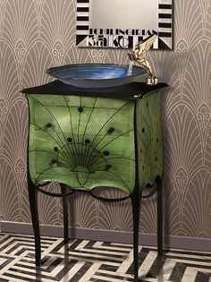 https://flic.kr/p/RrzF5N | Combination of Art Deco Items| washbasin of wood, ceramic, stainless faucet . Mirror in black and carved stripes. Floor white black marble . wallpaper in artdeco design. Deco is a style of visual arts, architecture & design that first appeared in France just before World War I.It became popular in the 1920s and 1930s, and influenced the design of buildings, furniture, jewelry, fashion, cars, movie theaters, trains,  and everyday objects such as radios and vacuum…