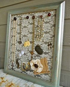 picture frame with push pins.  There are many ways you can dress this up.