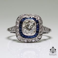 Period: Art deco (1920-1935) Composition: Platinum Stones: - 1 Old mine cut diamond of J-SI3/I1 quality that weighs 1.18ctw. - 25 Natural calibrated French cut sapphires that weigh 1ctw. - 28 Old mine