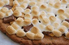 s'mores pizza: chocolate chip cookie dough crust, crushed grahams, hershey's, and mini marshmallows! nom!