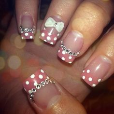 Acrylic nails. Clear base w/ glitter pink white polka dot tips, rhinestones, 3D nail art bows