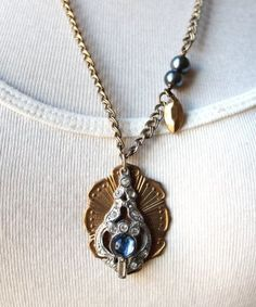 Vintage pendant with mixed metal chain.