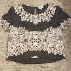 Beautiful Crop top This is a beautiful top that looks great with jeans or a skirt! Wish I were a little smaller so I could keep it! ECI Tops Crop Tops