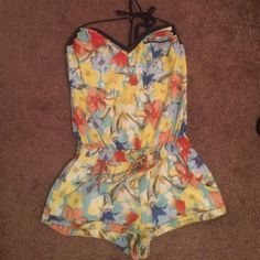 Hollister Spring Romper  Hollister romper with beautiful pattern and colors. Ties around the neck. Also ties on the bottom, can be adjusted. Hollister Other