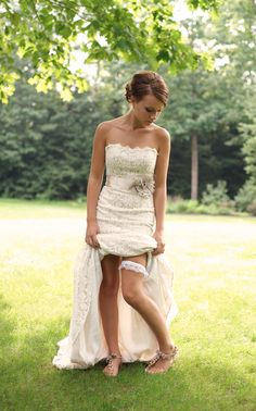 The dress must be lace. It's beautiful and has the vintage, rustic feel I'm looking for... Again, with a touch of glamour.