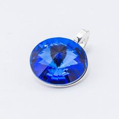 Silver plated Swarovski Rivoli Pendant 12mm Sapphire  Dimensions: length: 1,7cm stone size: 12mm Weight ~ 1,40g ( 1 piece ) Metal : silver plated brass Stones: Swarovski Elements 1122 12mm Colour: Sapphire 1 package = 1 piece Price 9.40 PLN(about 2.5 EUR) Swarovski Pendant, 1 Piece, Silver Plate, Silver Jewelry, Sapphire, Pendants, Brass, Sterling Silver, Stone