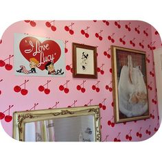 Cherry Print Pink Scratch & Sniff Wallpaper with an I Love Lucy poster & framed Minnie Mouse & Marilyn Monroe Photos and a Mirror in a Bathroom- from Hayley Williams of #Paramore (I think this is actually Hayley's bathroom at her [soon-to-be-past] home) - ☺, on Instagram #CherryPrint #cherries #ILoveLucy