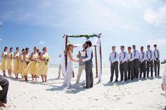 Stunning beach wedding, wearing THEIA's petal gown