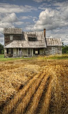 Old Farm House By Harvested Field