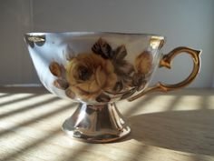 Gold brown and translucent flowered china cup by WanderingSaint, $15.00
