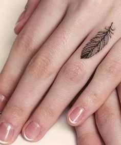 Coolest Feather Tattoos on Finger for Girls
