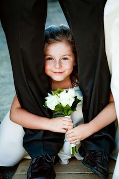 San Diego Wedding Photography: True Photography captures little flower girl hiding between dads legs duirng wedding in San diego