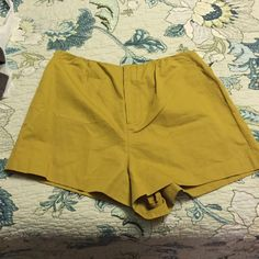 Olive green shorts kate spade Saturday Beautiful olive green shorts with pockets.  They look really cute on kate spade Shorts