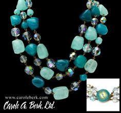 Exceptional triple strand of glass beads in colors of sea foam with iridescent faceted spacers. This is stunning! $395.