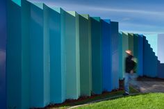 Boex designed a security fence that would enhance the environment in the garden, and was definitely less intimidating than a steel wire fence. Acoustic Baffles, Green Colors, Colours, Mental Health Facilities, Stainless Steel Panels, Wire Fence, Garden Spaces, Green Grass, Health Care
