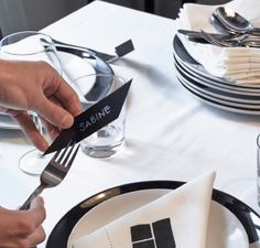 Keep place settings simple with handwritten name tags slotted into the forks.