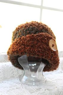 What a lovely Chemo Cap, or just a stylish and warm hat for you! This cap uses a 6 weight of yarn. The yarn of choice is Lion Brands Homesp...