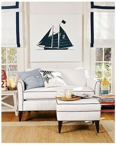 White couch and navy piping