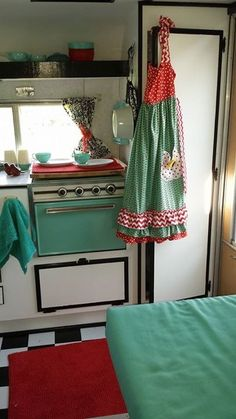 Interior. Mint green, red, black & white checkers. Tiny Trailers & Vintage Campers. <O>