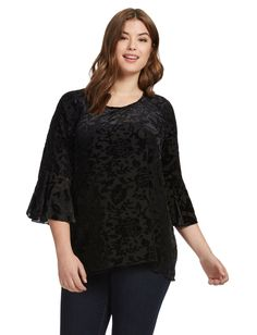 Semi-sheer velvet top with scoop neck and three-quarter bell sleeves,  stretch fabric, back keyhole cutout with button closure, jersey insert.