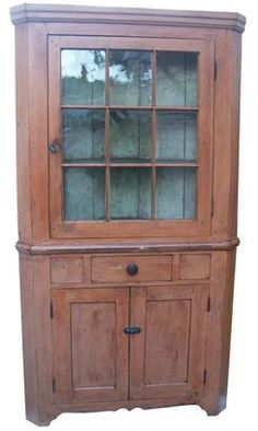 Hagerstown, Maryland 19th century Two pc Corner Cupboard with nine window lites, , original rare salmon paint on the exterior