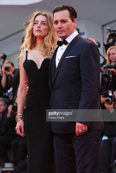 Johnny Depp and Amber Heard attend a premiere for 'Black Mass' during the 72nd Venice Film Festival at on September 4, 2015 in Venice, Italy.