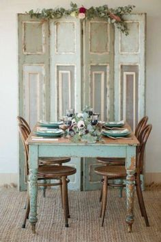 chippy turquoise table with Bentwood bistro chairs and a gorgeous painted screen.