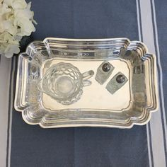 This unique shiny silver plated tray is so pretty! The edges have a sort of ruffled/scalloped pattern with detailed outlining and an overall