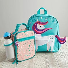 Our Wild Side Backpack has more than enough qualities to make anybody go a little wild. For starters, it was designed just for us by artist Sabina Gibson, so you won't find this beauty anywhere else. Not only that, but the top handle and adjustable, padded straps make them a breeze to carry. And, since they coordinate with our Wild Side Lunch Boxes, you'll have a complete set to go wild for.