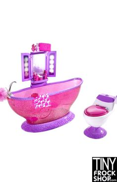 This is a fun set and is BRAND NEW IN BOX! Barbie tub with attached fold out vanity mirror. Comes with a bunch of accessories including puff sponge, makeup, towel and more! Also comes with coordinatin