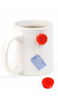 Tea button // sticks onto any mug to hold the teabag string in place! #product_design