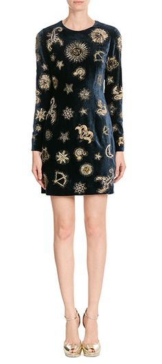 Embroidered with gold-tone thread, this midnight blue Emilio Pucci dress is made even more dramatic in plush velvet. The unfussy shift silhouette and long sleeves keep it easy to style #Stylebop
