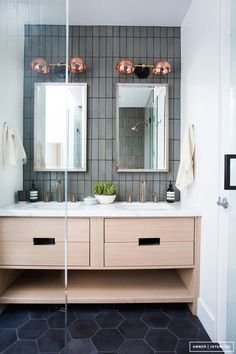 vertical subway tiles mixed with hexagon floor tiles to create different textures in the bathroom // love the copper scones over the mirrors